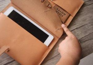 travel leather portfolio logo