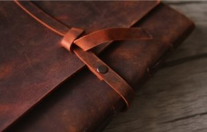 red leather bound journal