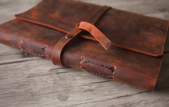 red leather notebook journal
