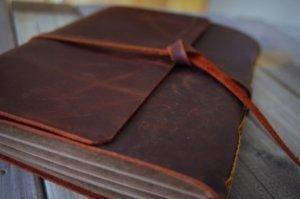brown leather photo album