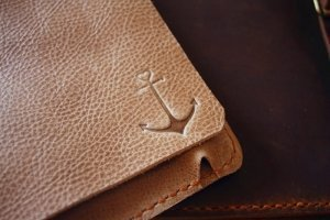 logos on leather tablet case