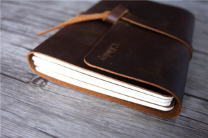 thick handmade brown leather bound notebook