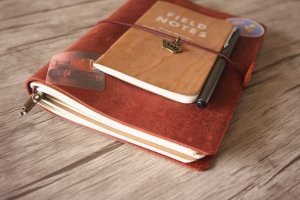 red leather diary notebook journal